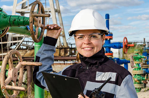 woman engineer checking oil and gas equipment