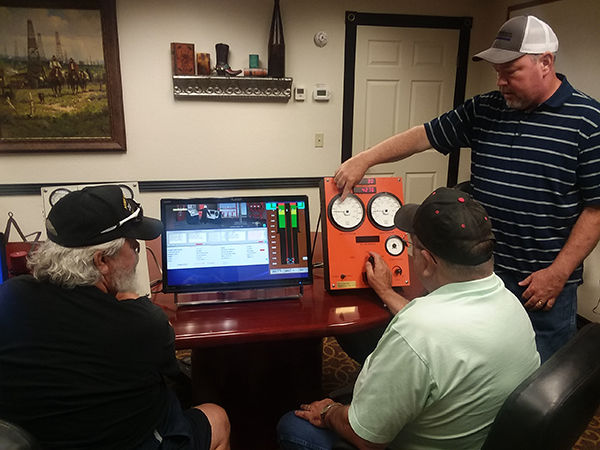 instructor demonstrating simulator equipment at Global Well Control